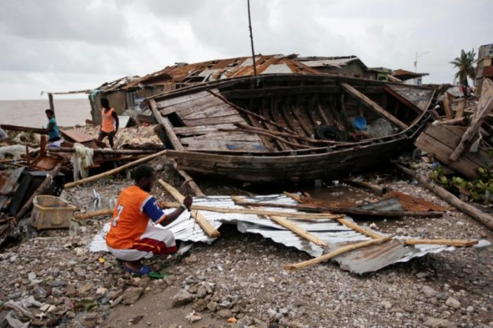 A man clears debris after Hurricane Matthew in Les Cayes, Haiti, October 5, 2016. REUTERS/Andres Martinez Casares