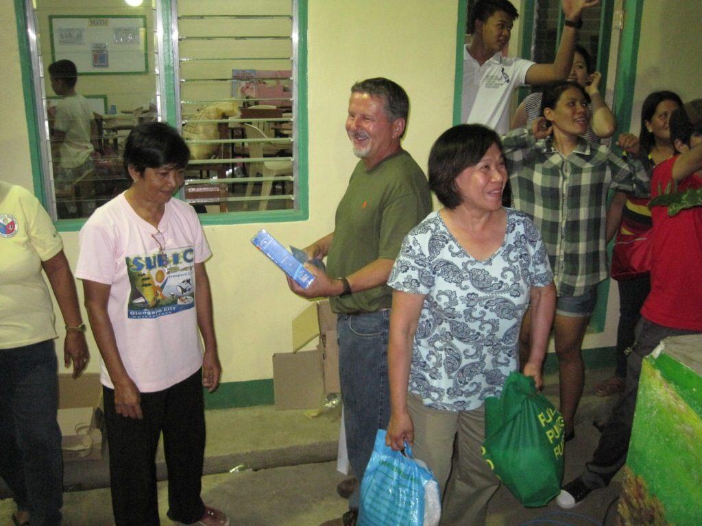 John, Lilia, and friends make the food distribution.