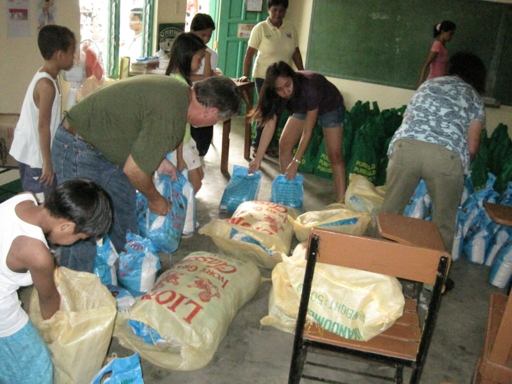 Rice and food is prepared for pre-identified families.