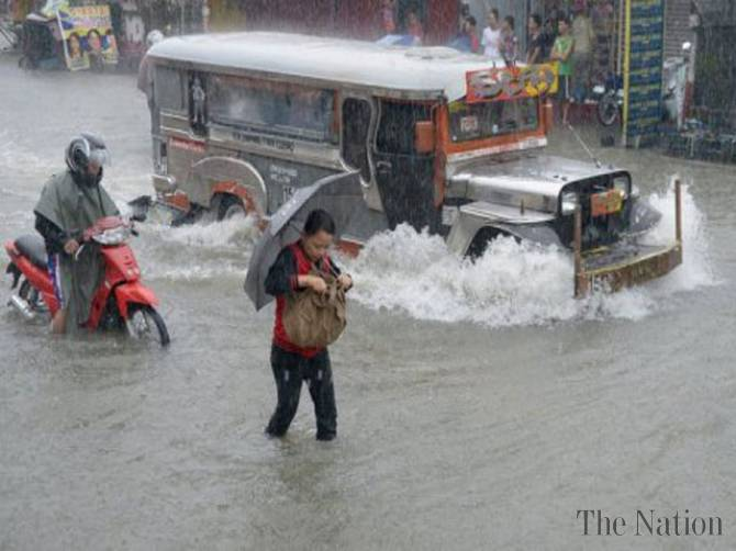 Heaviest rains in recorded history start to taper. Flooding widespread.  photo by The Nation.
