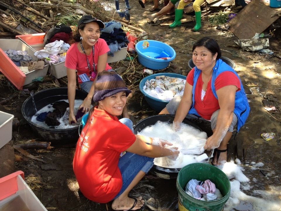 Many bins of mud-soaked clothes were washed