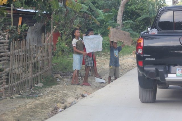 children in isolated communities seek the help of those travelling the main highways