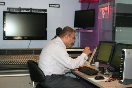 Diler, working in his garage - turned - studio, producing programs in Arabic, Kurdish and Turkish.
