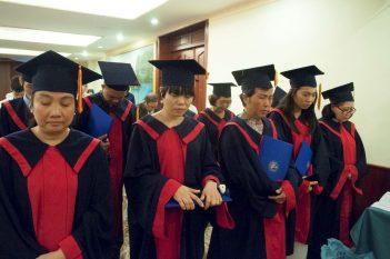 graduates praying