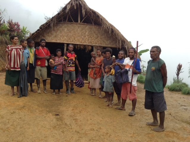 The Bokamamb Nazarene Church with a few of the Christians who were there. Pastor Abram River is fourth from the left.