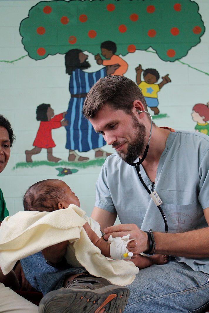 Dr. Ted and Baby at Kudjip Nazarene Hospital