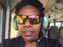 Dr. Imelda Assaigo, getting a cockpit view of the flight to Dusin.