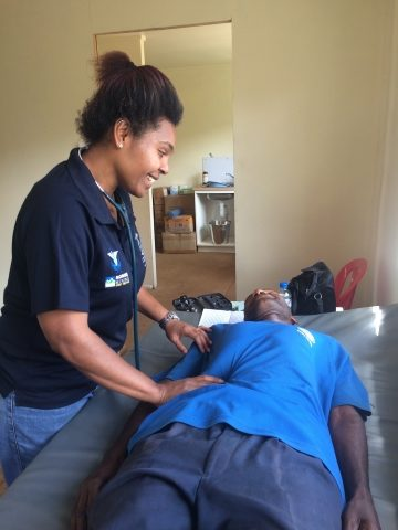 Dr. Imelda seeing a patient at the new Dusin Clinic.