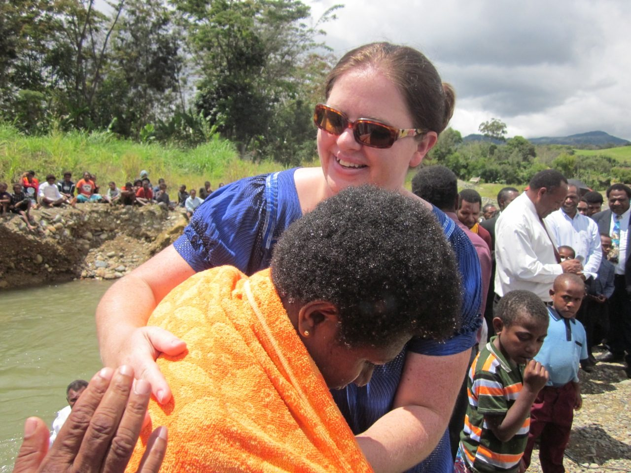 Placing towels around the students after their baptism.