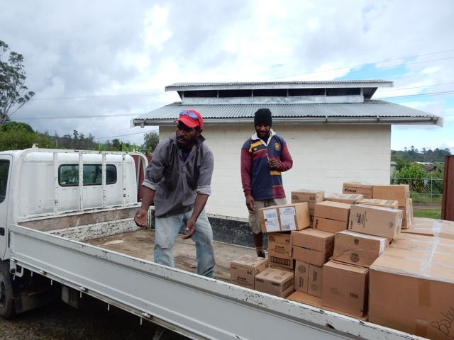 Unloading the containers and delivering the supplies.