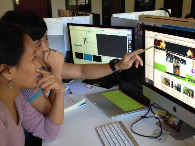 New Media Team, Ernalynn Longcop and Kenaz Nepomuceno working on FEBC web development.
