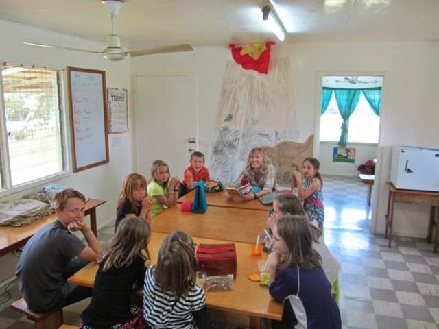 Rachel reading with missionary children at the MK school.